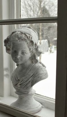 (I have this bust--she wears a hat on my dressing table.