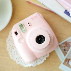 This retro pink camera would be a great touch on tables at a wedding reception.