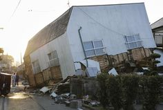 At least nine people were killed and 860 injured by a magnitude-6.5 earthquake that knocked down houses and buckled roads in Kyushu on Thursday night. The