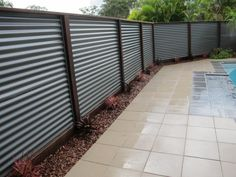 Hardwood posts and colorbond corrugated iron fence