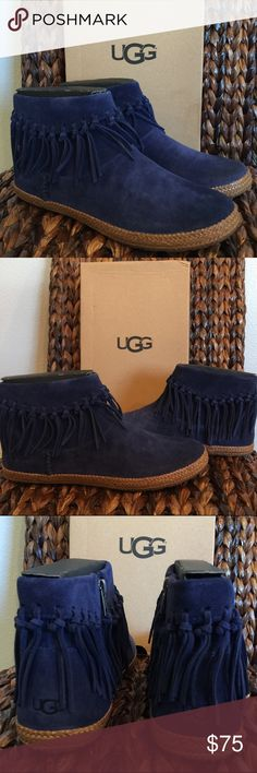 "UGG Navy Shenendoah Ankle Boots Knotted fringe adorns the cuff of a burnished suede ankle boot finished with PORON(R) cushioning for superior comfort.  Sizing: Runs small; order next size up. - Round toe - Fringe detail - Side zip closure - Genuine shearling lining  - PORON(R) cushioned footbed - Approx. 4"" shaft height - Imported Materials Suede upper, genuine lamb shearling (origin: Australia) and leather lining, rubber sole UGG Shoes Ankle Boots & Booties"