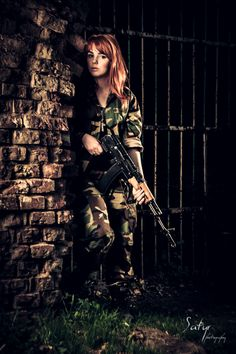 Perfect for story, except for hair.   She stood in the shadows, her gun trained on the guards. Waiting until they turned their backs to step out of the darkness.