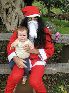 That Scary Santa that lives in the woods behind The Home Depot.  ~ 34 Creepy Mall Santas ~ Sittting on Scary Santa's Lap ~