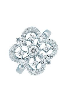 Can I haz?An ornate filigree clover setting is illuminated by pavé diamonds, defining an elegant ring cast in 18-karat white gold.