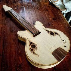 Progress on the Meridian electric uke!  #ukulele #ukulelemaker #music #guitar #guitarmaker #madeincanada #madeinmontreal #uke #cnc #woodworking #valleyworkshop #wood #ash #electricguitar #electricukulele #laserengraved #epiloglaser #lasercut by tolhurstguitars