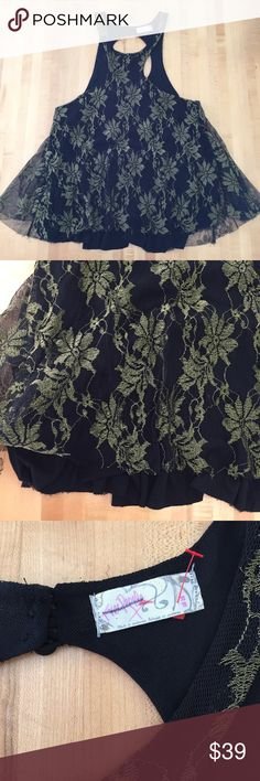 Free People Evening Tank Gorgeous layered free People tank perfect for a night out. Gold and black layers. Front is hip length and back is longer. Last pic shows the beautiful detail on the back. Make an offer. Perfect condition. Free People Tops Tank Tops