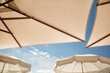 white patio umbrellas - Jean-Marc PAYET/Getty Images
