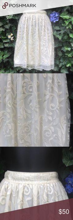 "NWT Anthropologie Chelsea & Violet Cote De Ivoire NWT ivory skirt. Waist 14"" elastic waist. Length 19.5"". Size XS Anthropologie Dresses"