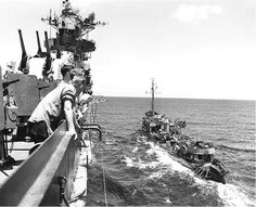 Destroyer USS Bainbridge refueling from carrier USS Hancock in the Atlantic Ocean or Caribbean Sea, 14 Jun 1944. (US National Archives)