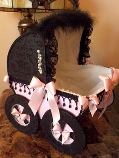 Personalized 14 inch Pink And Black Vintage Baby Carriage/Basket For Baby Girl / Baby Shower Centerpiece Decor. $39.00, via Etsy.