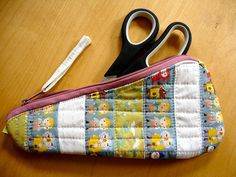 very smart. a zipper pouch contoured to fit just your scissors!