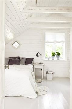I love the thoughts of an all white clutter free bedroom. Imagine the great dreams a gal could have here.