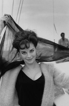 Portrait of actress Natalie Wood aboard boat, holding scarf behind her head. | California, 1962 | Photographer: Paul Schutzer