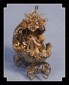 Expressions of Elegance heirloom egg carriage designed by Irene Wilson. Hand cut ostrich egg.