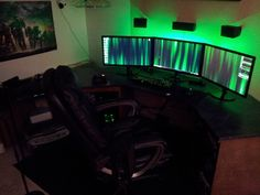 Triple monitor, with green light ambiance. #megadesk #battlestation #workstation