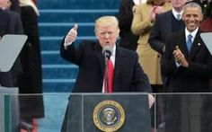 Comment: US President Donald Trump speaks to the nation during his swearing-in ceremony on January 20, 2017 at the US Capitol in Washington, D