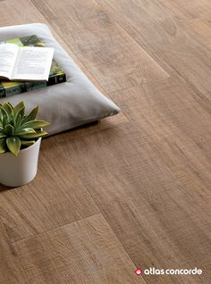 Wood look porcelain tiles with textured surface for outdoor applications. The textured surface for outdoor application that reproduces the saw cut finish with an alluring three-dimensional effect. | atlasconcorde.com | Made in Italy. Made to Excel. |