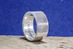 10mm Wide Fingerprint Wedding Ring with Tip Print on the Outside and Your Handwriting on the Interior. Touched by the one you love. Handmade by Brent&Jess in Maine. See more here: http://www.brentjess.com/product-page?prodid=1637