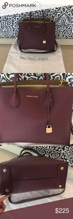 Michael Kors Mercer tote Used once this is the large Mercer tote in the plum shade. Dust cover included. Michael Kors Bags Totes