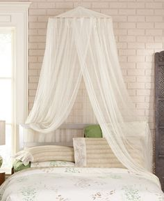 Create an ethereal escape right in your own home with the Siam bed canopy from Mombasa. Sheer, flowing mosquito netting brings an exotic allure to any room you desire, including bedrooms, porches, and