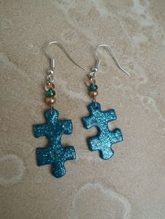 Earrings Upcycled Puzzle Piece  - Turquoise Glitter and Champagne. $11.00, via Etsy.
