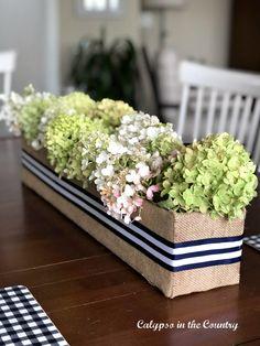 DIY Flower Box Centerpiece made from a cardboard box and burlap Diy Flower Boxes, Diy Flowers, Flower Box Centerpiece, Centerpieces, Burlap, Hessian Fabric, Centerpiece, Table Centerpieces, Center Pieces