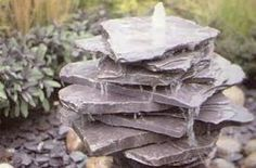 small water fountains made of natural stones are simple garden designs