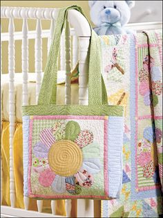 A baby quilt with matching diaper bag. Too cute!