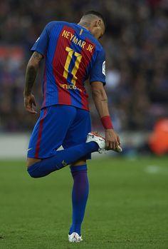 Neymar JR of Barcelona checks his boot during the La Liga match between FC Barcelona and Malaga CF at Camp Nou stadium on November 19, 2016 in Barcelona, Catalonia.