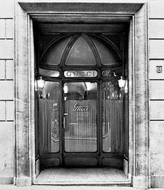 1938 Gucci's Rome store - at the foot of the prestigious Spanish Steps on Via Condotti in Rome on the site of Gucci's original Rome boutique.  Today appears a new contemporary design conceived by Frida Giannini with original aspects of the store.  The new entrance replicates the famous door of the Dolce Vita era. The art deco inside; glass and gold plate lamp shades, inspired by original fittings, re-produced by artisan craftsmen, with 18th century vaulted ceiling on the ground floor.