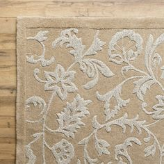Anchor your dining room or define space in the den with this hand-tufted New Zealand wool rug, showcasing a raised floral motif. Features: