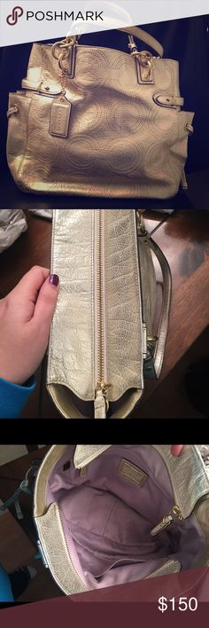 "Gold coach purse Gold shimmer coach tote. Large tote. Has gold hardware and features ""new"" updated coach C's. Lining is a light purple (lilac/lavender). Has zip closure and we'll as zippered pocket inside and two pockets for cell phones and such. Coach Bags Totes"