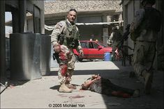 """Prosser stands above the crocodile who bit his watch. You can read a firsthand narrative about CSM Prosser and LTC Kurilla in Michael Yon's dispatch, """"Gates of Fire."""" click picture to read."""