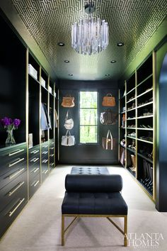 One of Lee's favorite rooms is the custom walk-in closet, complete with custom black cabinets and brass T-bar hardware; the ceiling is equally as showstopping, thanks to art deco GP&J Baker wallpaper