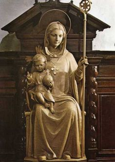 Maria, Abbatissa Nostra-  It was not uncommon in the Middle Ages to refer to the Madonna as The Abbess.  When you see her holding the crosier, you are seeing her in this aspect.