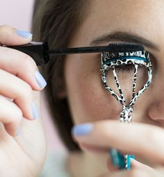 Curl your lashes with an eyelash curler while applying mascara at the same time to keep them curled longer