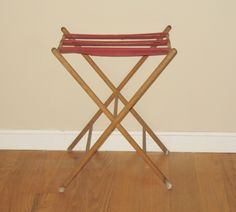 A very smart polished wooden luggage stand in mahogany - also ...