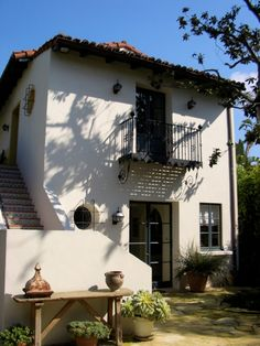 Buenaventura wood shutters and spanish revival on pinterest for Spanish style window shutters