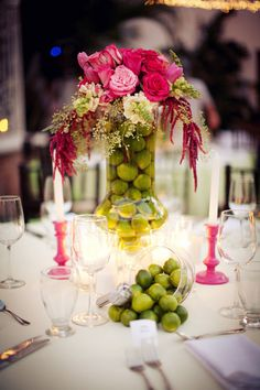 pretty arrangement with limes in the bottom of the vase<3