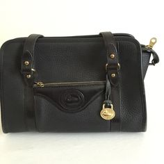 Vintage Dooney & Bourke Shoulder Bag Vintage Dooney & Bourke... Black pebbled leather. This bag is vintage in excellent unused condition.  Kept stored very well. Hardly used, very clean. This bag measures 11x8 1/2, its in mint condition as you can tell! Dooney & Bourke Bags