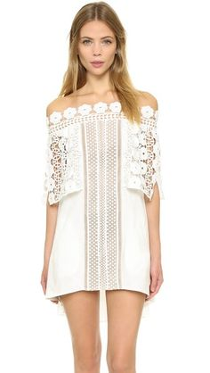 A floral lace overlay accents this bohemian-inspired off-shoulder Self Portrait shift dress. Contrast lining at center panel - get even more style and shopping inspiration on http://jojotastic.com/shop-my-favorites/