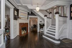 Historical Queen Anne house in Glen Ellyn IL for sale has original coal fireplace and this stunning staircase. Beautiful windows and lighting and the turret is one of the most lovely.