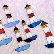 Here are some fun lighthouse suncatchers made out of stained glass. These would look great in a bathroom, particularly if it has a nautical theme and does not need to be in direct sunlight to look good but can be hung in any window or even on a mirror....