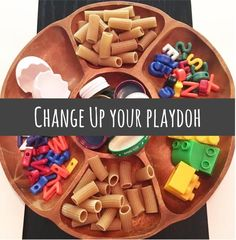 """Rather than using the traditional Play-doh supplies, expand your toddler and preschooler's creativity by placing """"loose Parts"""" on the table for them to explore with with the homemade playdough."""