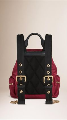Burberry Rucksack in lightweight nylon with leather and polished metal chain detail. Inspired by the fabric of the Burberry trench coat, the nylon is made in a compact gabardine construction with a durable and water-resistant finish. Discover more accessories at Burberry.com