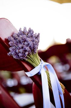 lavender bouquet on a aisle chair