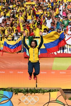 Mariana Pajon of Colombia jumps in the air on the podium after being presented with her gold medal after winning the Women's BMX Final on day 14 of the Rio 2016 Olympic Games at the Olympic BMX Centre on August 19, 2016 in Rio de Janeiro, Brazil.