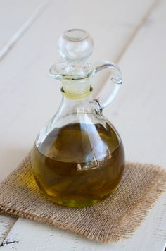 Lustrous Locks: Slightly heat 4 tablespoons of olive oil, massage it into your scalp and hair, cover your head with a plastic bag (secured with a hairclip), and leave it for up to 1 hour; rinse, then shampoo and condition your hair as normal