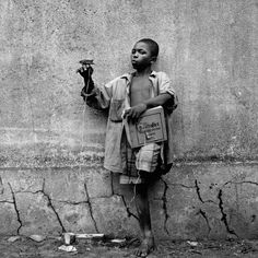 Kinshasa, Democratic Republic of Congo, October 2002. ''It's hard to imagine Tim not making an intimate picture. He approached everyone with curiosity and an open heart that few could resist; he left behind a world of people who knew him as a friend, however brief their encounter. Tim met Jonathan on the streets of Kinshasa in 2001. Jonathan had been living on the streets for five years, having been bullied by his stepmother. Tim's notes tell us that his dream was to learn to write and to…