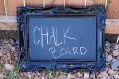 black framed chalk board. black plastic frame. rectangle. chalk board. home decor. chalk. frame
